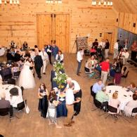 With high vaulted ceilings accompanied with rich wood floors and beams, creates a scenic atmosphere for wedding receptions!