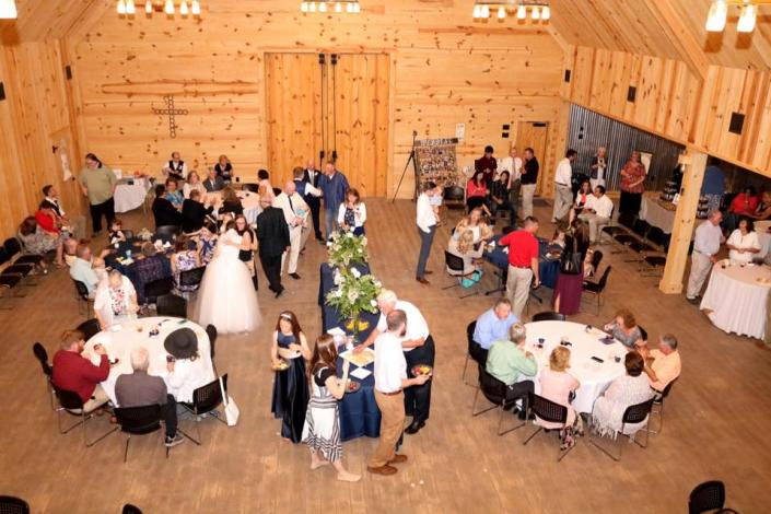 [Image: With high vaulted ceilings accompanied with rich wood floors and beams, creates a scenic atmosphere for wedding receptions! ]