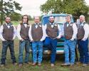 These groomsmen depict a stylish, rustic appeal posing in front our antique truck!