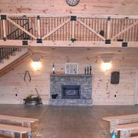 "The highlight of our barn is our rustic, stone fireplace where many couples to choose to say, ""I do!"""