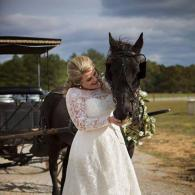 There are so many unique photo opportunities here at Triple H Barn as seen with this bride posing with a majestic horse.